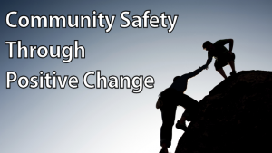 photo of one climber helping another- Community Safety Through Positive Change