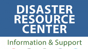 DRC Information & Support sign with various disaster logos