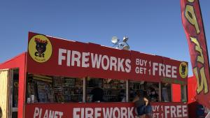 Fireworks stand with customers.