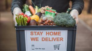 Box of groceries delivered at a door