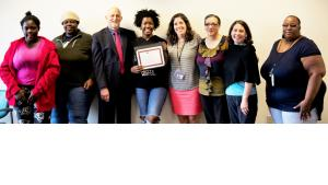 Kalisha Spikes poses with family and DCJ staff