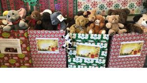 Stuffed animals overflowing out of gift wrapped boxes