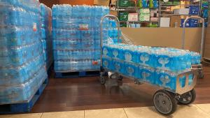 Water at the JOHS' supply center awaits pickup by outreach teams on Friday, June 25.