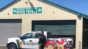 Multnomah County Sheriff's Office employee with donation of life vests