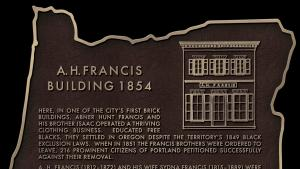 Historic plaque on Morrison Bridge honors one of Oregon's first African American businesses.