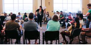 Graziella Loele, an Americorps and Jesuit volunteer organizes cultural orientation classes at Catholic Charities