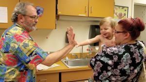 baby high-fiving a nurse
