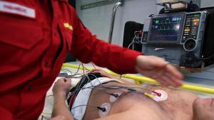 paramedic helping someone in ambulance