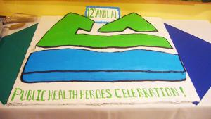 cake in the shape of the Multnomah County logo
