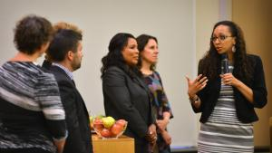 Program director Rachael Banks speaks at Monday's grant announcement celebration as Board of Commissioners look on>