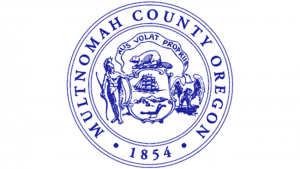 """An image of the Multnomah County Seal, bearing the state motto """"Alis volat propriis"""""""