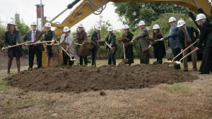 County Commissioners, state lawmakers, judges and members of the courthouse project team break ground on new central courthouse