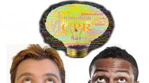 two men looking up at a graphical light bulb over their heads