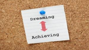 photo of bulletin board with dreaming achieving
