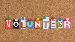 photo of bulletin board with word volunteer
