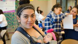 Smiling Latina mom and baby
