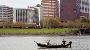 people in a boat fishing near the Portland waterfront