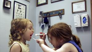 girls playing doctor in exam room
