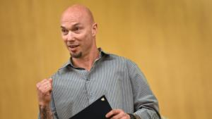 The Department of Community Justice client Carey Markwell pumps his fist in recognition of his accomplishments during his first 120 days in the Multnomah County Justice Reinvestment Program.