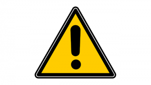A yellow triangle with a bold black exclamation point, in the style of a road hazard sign.
