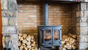 Wood stove with stacked and split fire wood