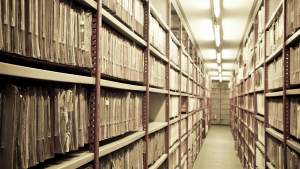 Shelves of archived paper material
