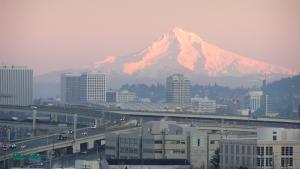 Mount Hood with a cityscape in front of it