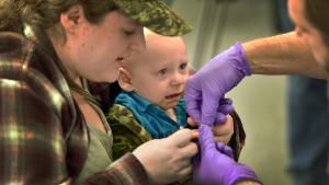 County lead specialist Perry Cabot tests a teary-eyed Luke Klassen as he is comforted by his mother Nikki Meyers.