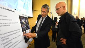 Architect Tom Vanderveer shares information about the preferred site with open house guest.