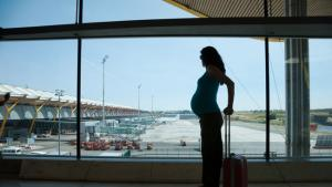 pregnant woman waiting in the airport