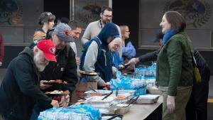 Neighbors gather for a meal at a Portland shelter