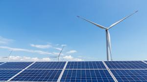 Solar panels and wind turbine create renewable electricity