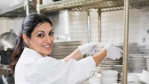 woman stacking dishes