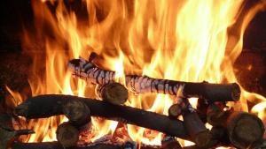 blazing fireplace logs