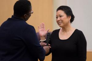 Commissioner Lori Stegmann, representing District 4 gets sworn-in by the honorable Judge Adrienne Nelson at Tuesday's ceremony.