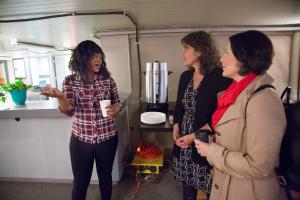 Shelter manager Lawashia Smith, from left, talks to Multnomah County District 1 Commissioner Sharon Meieran and District 3 Commissioner Jessica Vega Pederson during the April 17 opening of the Columbia Shelter in the Shleifer Furniture building.