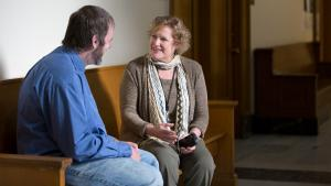 Diversion Courts Program Manager Jean Dentinger (right) chats with a Mental Health Court participant.