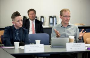 A Home for Everyone co-chair Stacy Borke of Transition Projects, left, with director Marc Jolin during the coalition's Aug. 21, 2017, executive committee meeting.