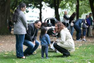 Chair Deborah Kafoury talks to the Subedi family during a welcoming rally in Portland