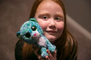 Surri Noelle and one of the stuffed animals she's collected for her new home through the Home for the Holidays campaign.