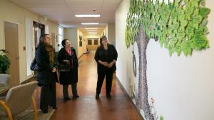 Cathe Wiese shows Chair Deborah Kafoury (left) and Commissioner Lori Stegmann (center)  around My Father's Place, a faith-based, non-profit family shelter in Gresham.