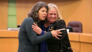 Commissioner Sharon Meieran comforts mother Charlene Turenne after an emotional listening session on mental health services