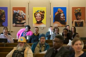 """Portraits from the """"Albina Queen"""" photo exhibition were hung on display on the walls of the Multnomah County Board Room."""