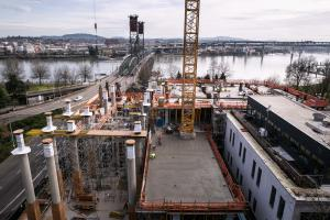 Lobby columns take shape at left as new central courthouse rises by Hawthorne Bridge
