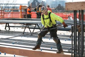 Construction worker installs steel rebar on third floor of the new Central Courthouse