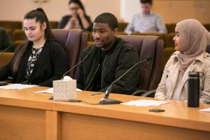 From left: Multnomah Youth Commissioners Charity Dunlevy-Todd; LaShawn McCarthy (speaking); and Balkhissa Noor