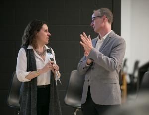 Chair Deborah Kafoury speaks with Metro Councilor Sam Chase during a discussion on reducing diesel emissions.