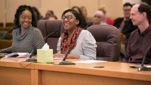 Nikoyia Phillips, a health educator with REACH, talks to commissioners