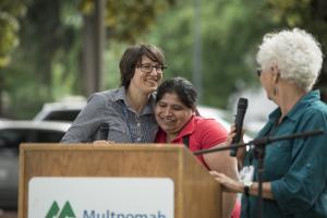 CSA coordinator Katy Pranian hugs Mid County Health Center client Paula Hernandez.