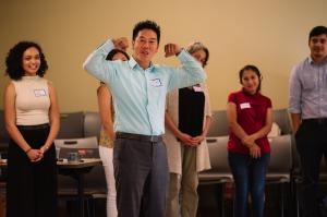 OPAL Environmental Justice Oregon Executive Director Huy Ong signalling during a team-building exercise that he wants to build power by the people.
